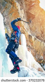Professional climber on icy waterfall