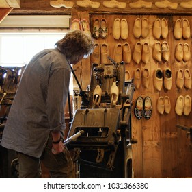 Professional clog maker in Holland - clogs lined up on wall
