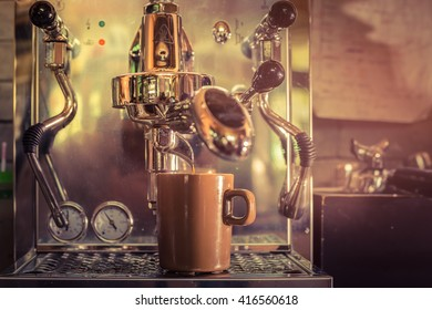 Professional coffee machine making espresso in a cafe.vintage filter
