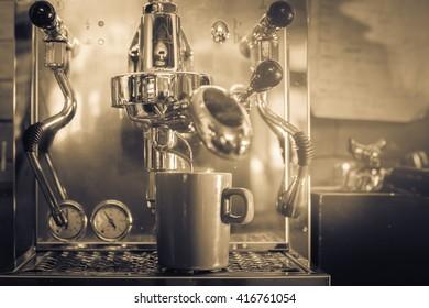 Professional coffee machine making espresso in a cafe.monochrome filter