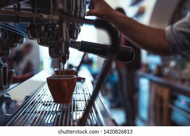 Professional coffee machine pouring espresso. Barista coffee making process.