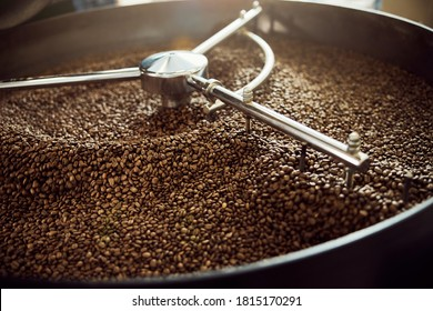 Professional coffee roasting machine with arabica coffee beans in stainless steel cooling bin