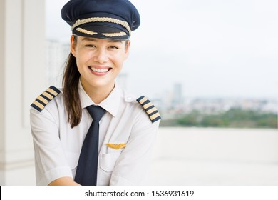 Professional commercial pilot woman at the airport. Aviation.