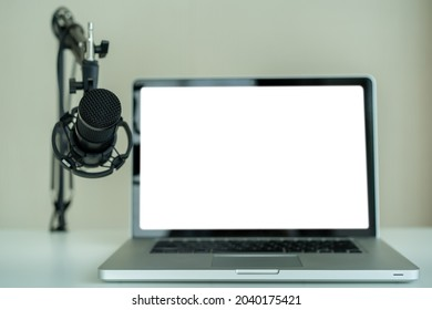 Professional condenser microphone on a microphone holder close up with copyspace. Live podcast and streaming concept at home.