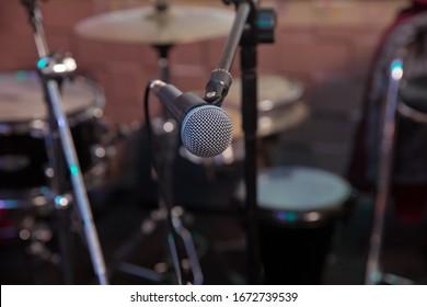Professional condenser studio microphone, Musical Concept. recording, selective focus microphone in radio studio, selective focus microphone and blur musical equipment guitar,bass,drum piano