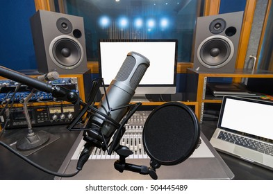 Professional condenser studio microphone over the music studio background, Musical instrument Concept