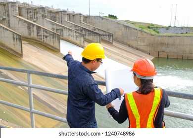 Professional Construction woman engineer Manager wear safety yellow helmet point at building project with better structures