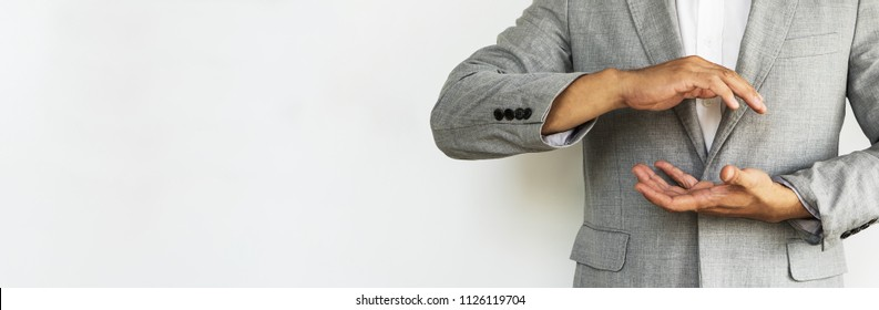 Professional consultant successful businessman wear gray suite white shirt hand holding protect and care on empty copy space background for business financial investment management strategy concept