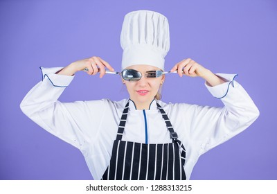 Professional cook of culinary school. Culinary arts academy. Culinary school concept. Woman professional chef hold utensil spoon fork having fun. Time to eat. Appetite and taste. Traditional culinary.