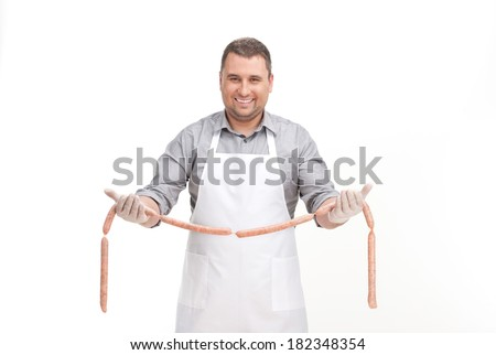 professional cook holding sausage smiling man stock photo edit now