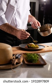 Professional cook in uniform add some spices to dish, decorating delicious meal for guests in hotel restaurant. food, cooking concept - Shutterstock ID 1932897809