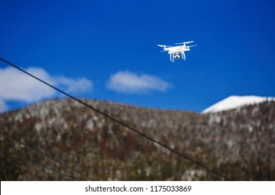 Professional copter camera flying high in mountains.Hike safely with aerial drone, film beautiful landscape from above.Modern flying video cam being used for safety and surveillance