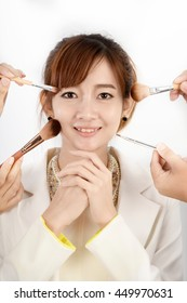 Professional cosmetic brush makeup and woman model
