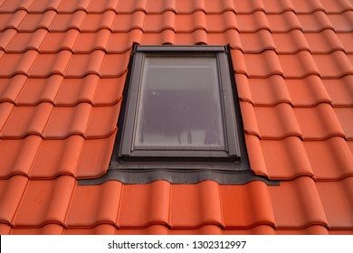 """professional  craftsman shows new work: window skylight model """"velux"""" in roof with red tiles"""
