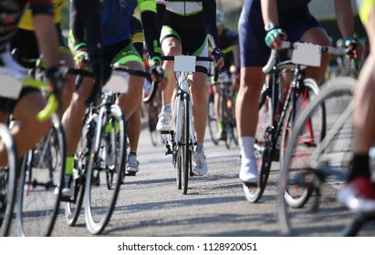 Professional cycling race with many athletes on the road closed to traffic