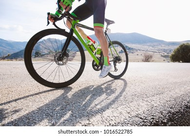 A professional cyclist on a mountain road