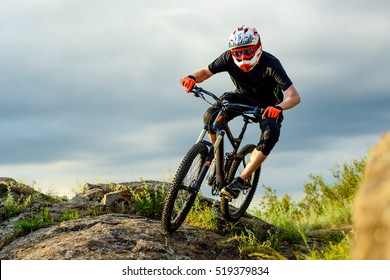 Professional Cyclist Riding the Bike on the Rocky Trail. Extreme Sport Concept.