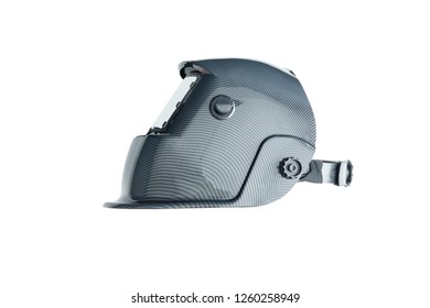Professional darkening protective welding helmet, viewed from the side isolated on white background