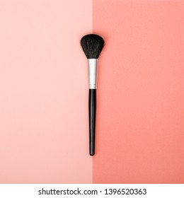 professional decorative cosmetics, makeup brush on color of year 2019 Living Coral background. beauty, fashion and shopping concept. trendy flat lay consept, top view
