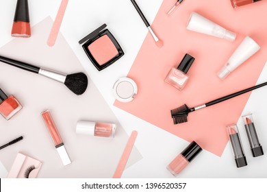 professional decorative cosmetics, makeup tools and accessory on white background. color of year 2019 Living Coral. beauty, fashion, party and shopping concept. trendy flat lay composition, top view