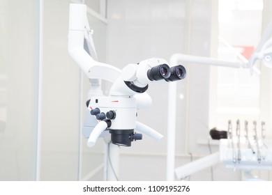 Professional dental endodontic binocular microscope in the treatment room