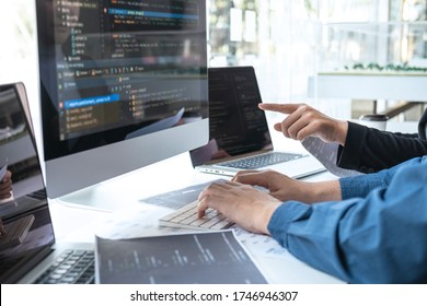 Professional Developer programmer cooperation meeting and brainstorming and programming in website working a software outsourcing and coding technology, writing codes and database.
