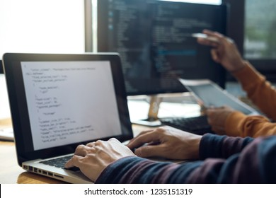 Professional Development programmer cooperating meeting and brainstorming and programming website working in a software and coding technology, writing codes and data code.