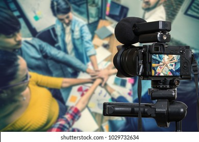 Professional digital Mirrorless camera with microphone recording video blog of Asian and Multiethnic Business people making pile of hands, Camera for photographer or Video and Live Streaming concept