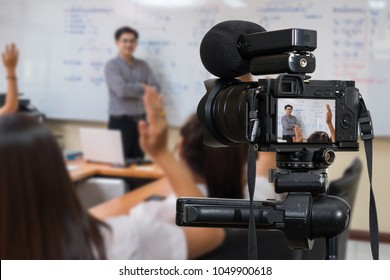 Professional digital Mirrorless camera with microphone on the tripod recording video blog of Asian teacher in the classroom,Camera for photographer or Video and Technology Live Streaming concept