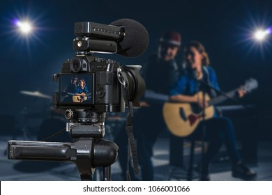 Professional digital Mirrorless camera with microphone recording video blog of Musician duo band singing a song and playing music instrument,Camera for photographer or Video and Live Streaming concept