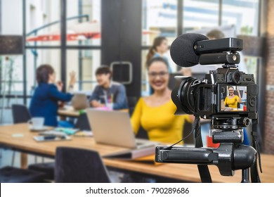 Professional digital Mirrorless camera with microphone recording video blog of Businesswoman working with Group Of Business people , Camera for photographer or Video and Live Streaming concept