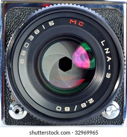 Professional digital photo camera with zoom lens on white background