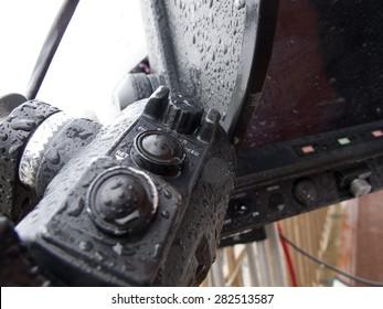 Professional digital video camera.  closed polyethylene camcorder against rain.