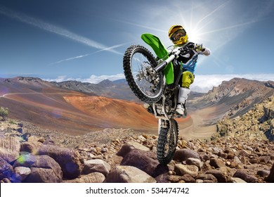Professional dirt bike rider doing wheely