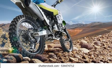 Professional dirt bike rider on top of vulcan closeup