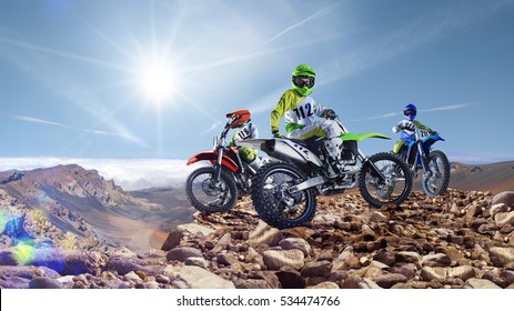 Professional dirt bike riders on top of vulcan