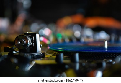 Professional dj audio equipment.Analog turntables tonearm with needle and vinyl record disc with hip hop music.Djs setup for playing musical tracks on concert,scratching records on rap battle event