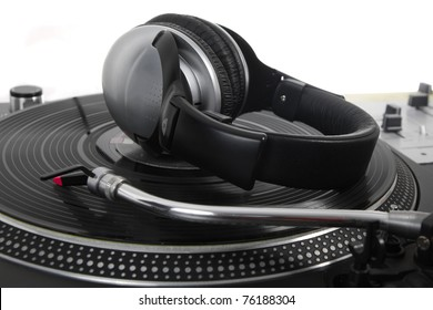 Professional dj headphones on turn table vinyl records player device.Stereo headphones headset on audio vinyl record player system.Hi-fi audio equipment for disc jockey in night club