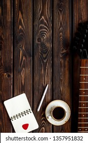 Professional dj instruments with guitar, notebook and coffee on wooden background top view mockup