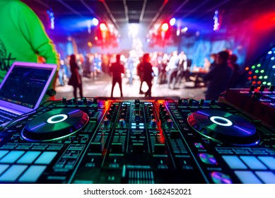 professional DJ music mixer at a party at an electronic music concert