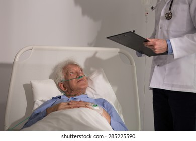 Professional doctor diagnosing his older sick patient