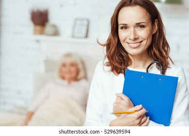 Professional doctor holding folder