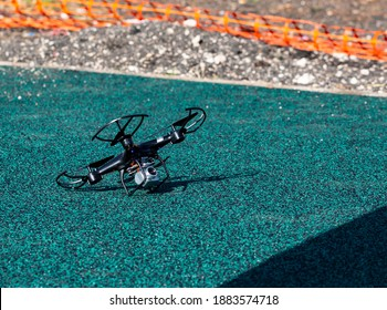 Professional drone quadcopter with digital camera in the playground. New technology in the aero photo shooting. black drone quadcopter crash. Fallen damaged quadcopter in the playground.