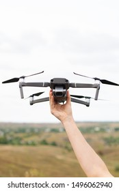 Professional drone video for aerial photography fly lands on a man's hand in nature. Concept of robotic modern gadgets and technology for help people. Vertical photo