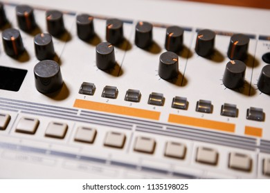 Professional drum machine for new electronic music composer.Play and remix musical tracks on studio session and night club concert with retro style synthesizer device.Push buttons and knobs