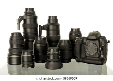 Professional DSLR camera and collection of lenses.