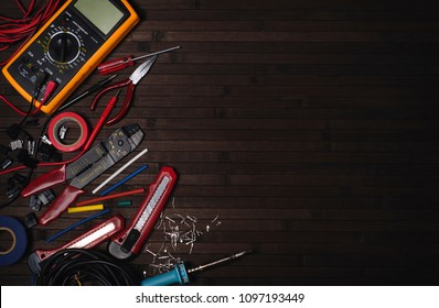 professional electrician tool kit on a wooden dark table