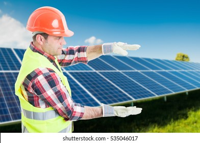 Professional engineer holding something invisible in his hands at photovoltaic station with text area