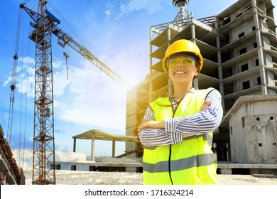 Professional engineer in safety equipment at construction site - Shutterstock ID 1716324214