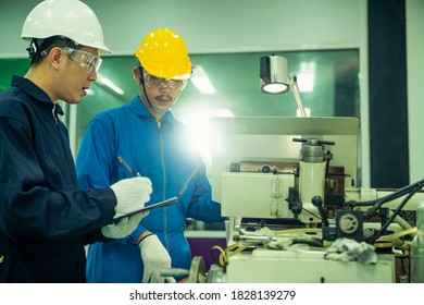 Professional engineering walking discuss inspecting with engineer team machinery factory area. Manager hand use tablet listenreport paper for internal audit. Quality assurance for manufacturing. New n